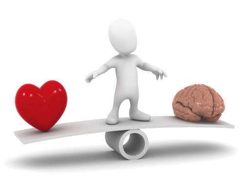 3d render of a little man on a seesaw torn between the heart and mind
